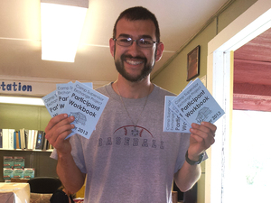 Noah with Booklets - Cropped.jpg